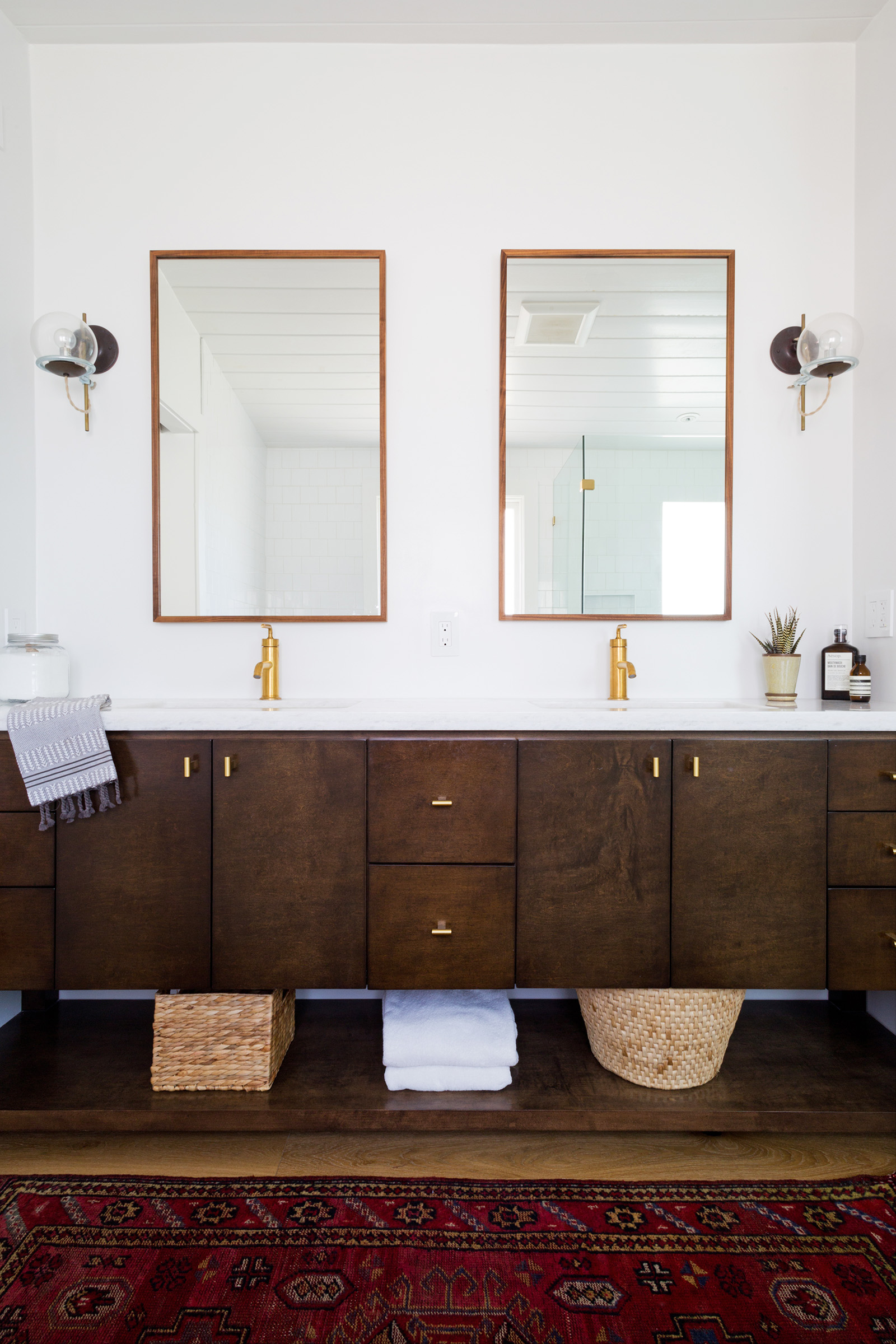 Custom mid-century modern wood bathroom vanity designed by Carly Waters Style