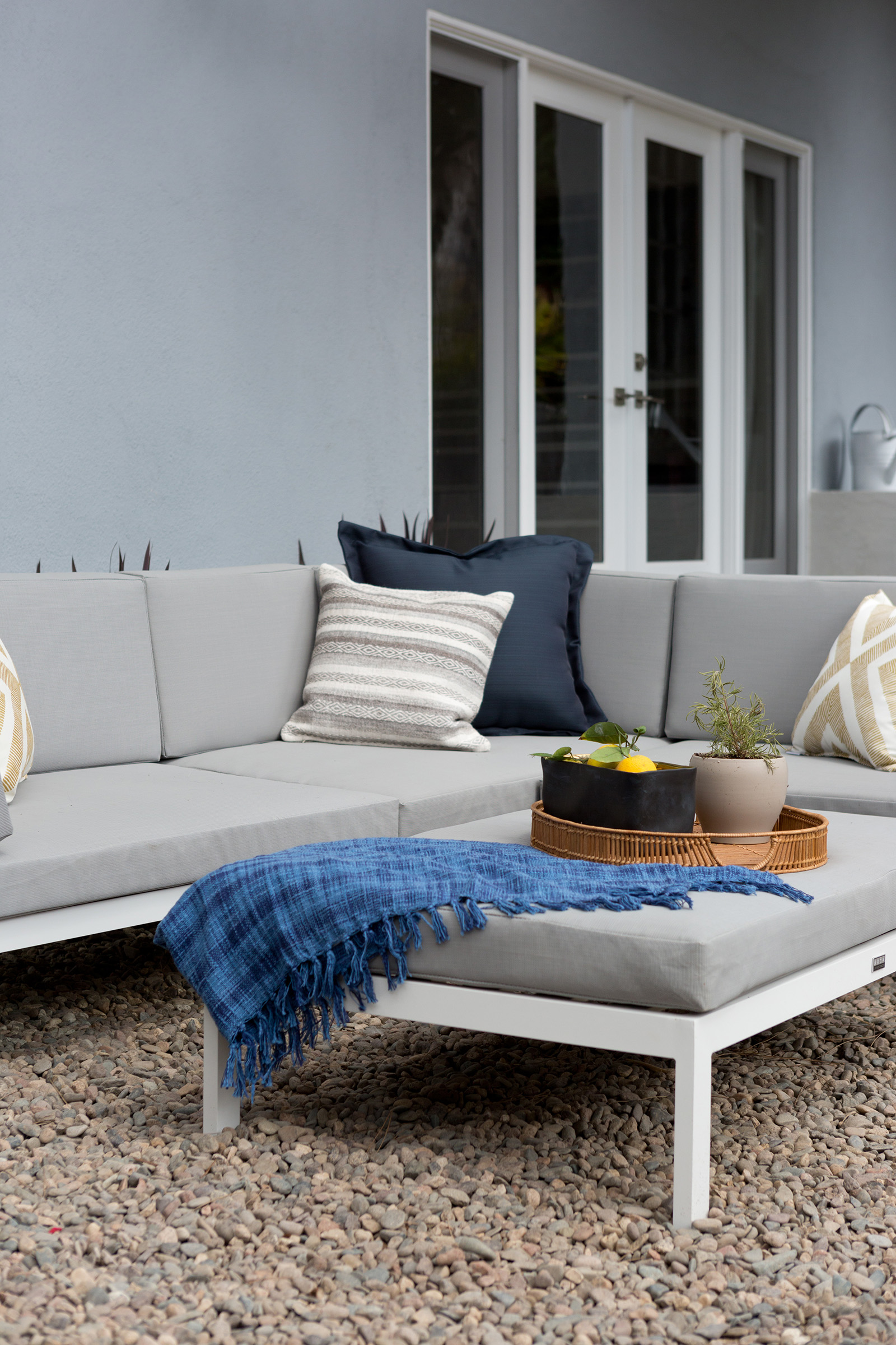 Modern outdoor living space design by Carly Waters Style