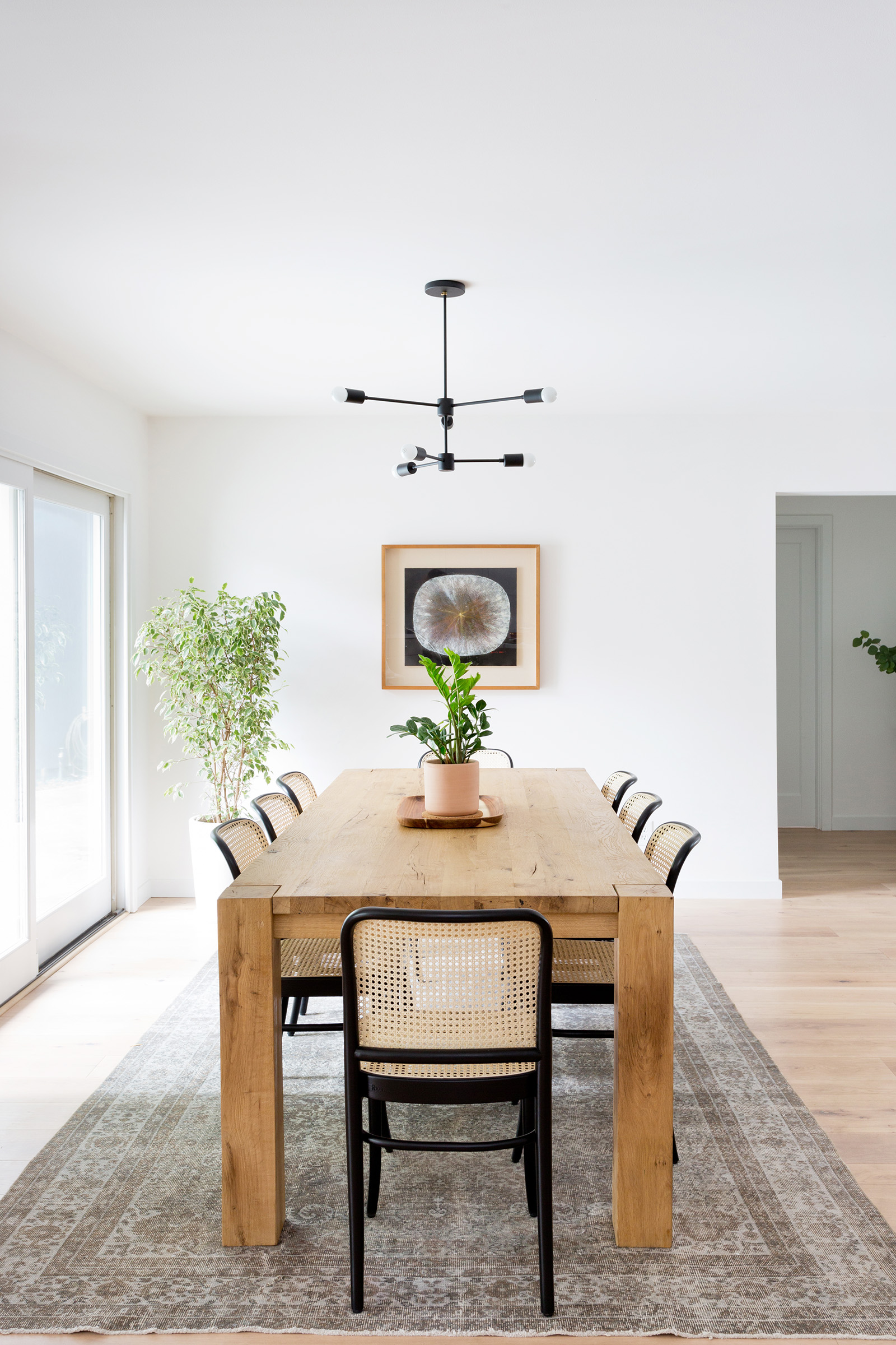 Warm & minimal dining room designed by Carly Waters Style