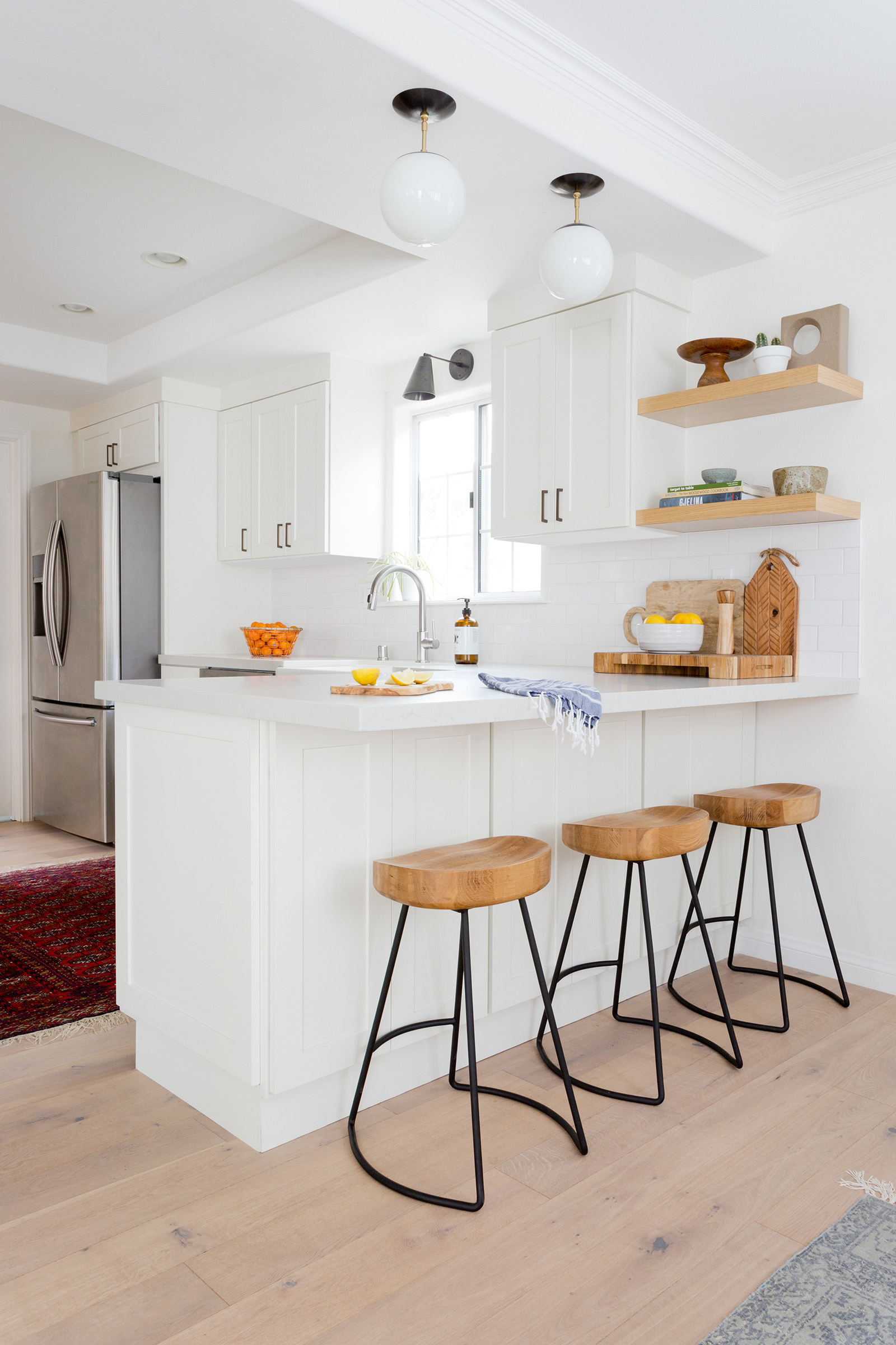Modern, white clean kitchen design by Carly Waters Style