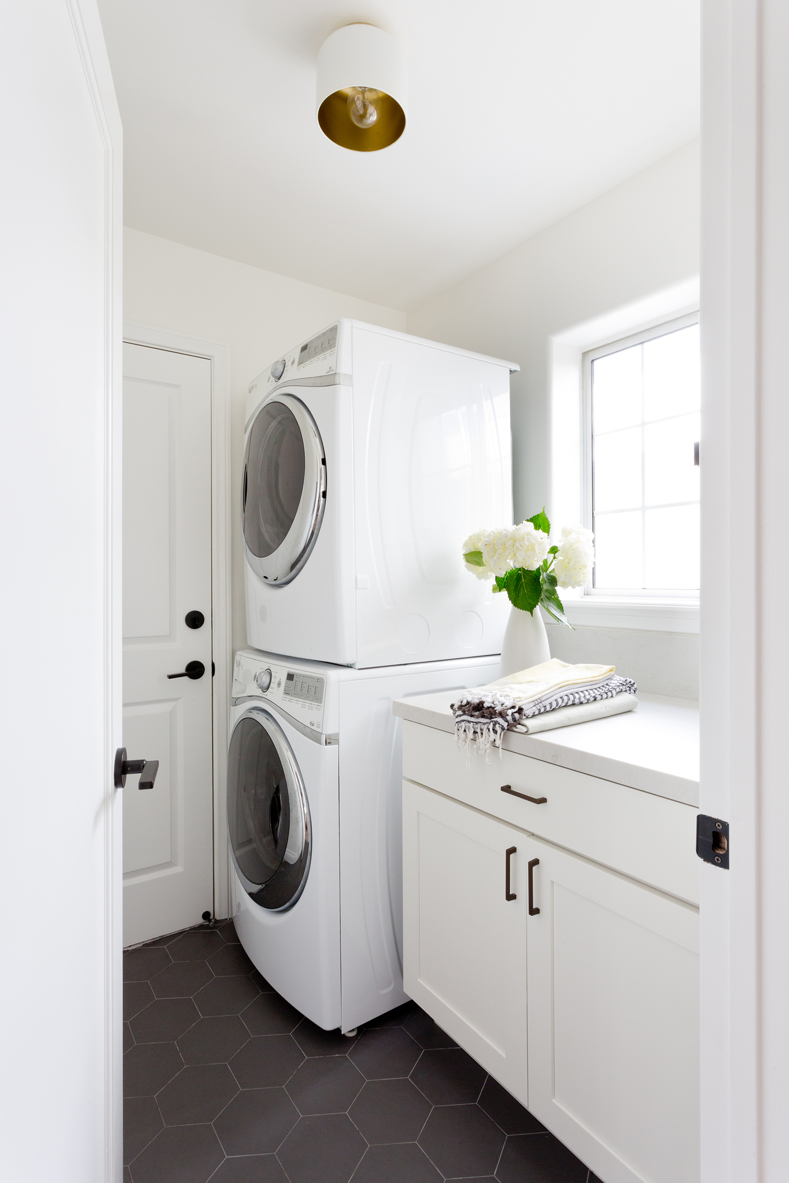 White and bright laundry room design by Carly Waters Style