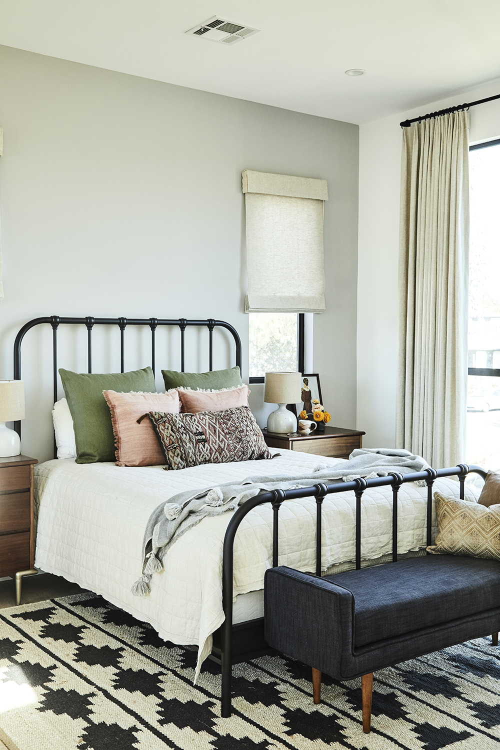 Warm master bedroom design by Carly Waters Style