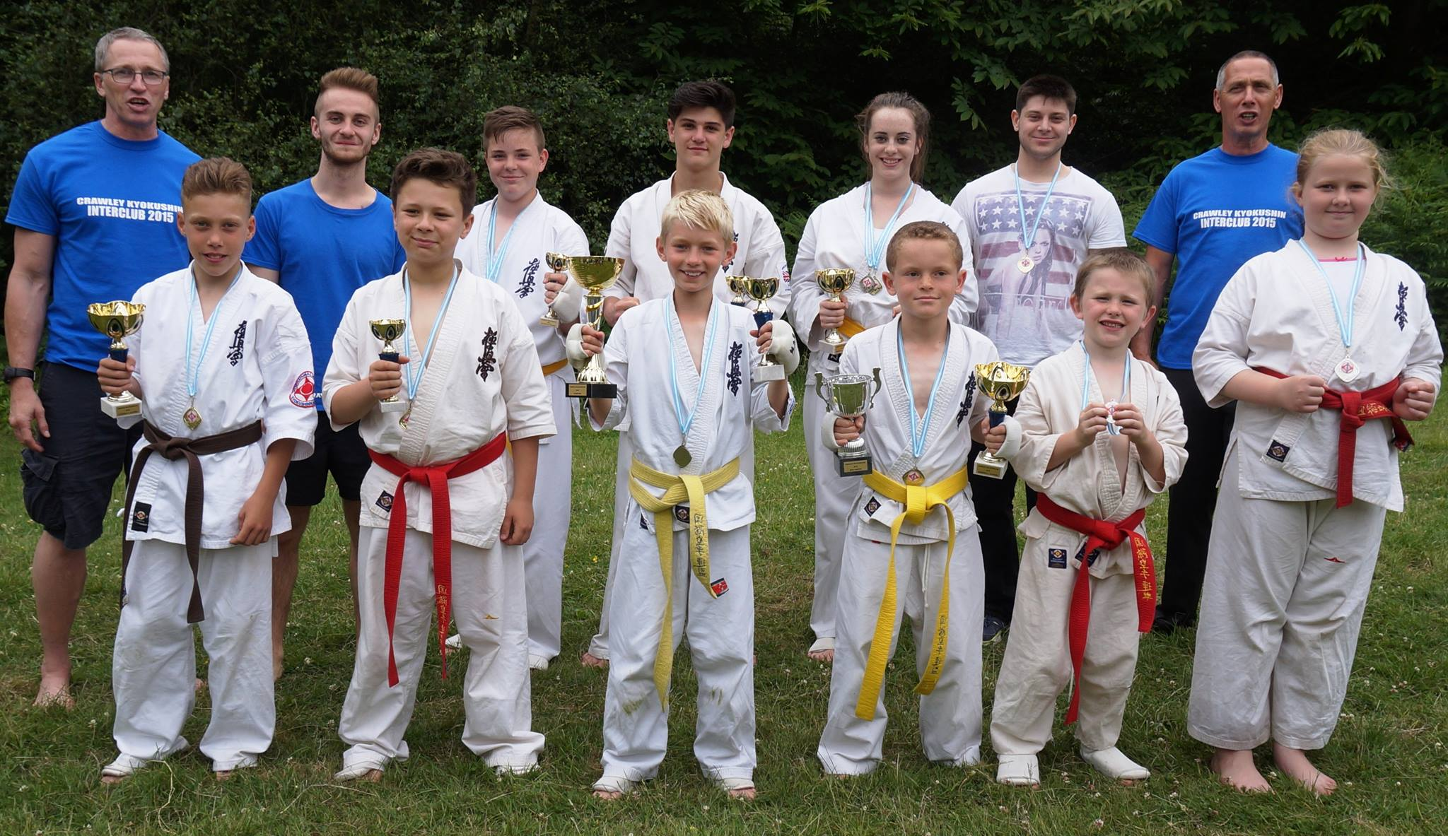 Shihan David Pickthall and Neil Madeley with last year's medal winners