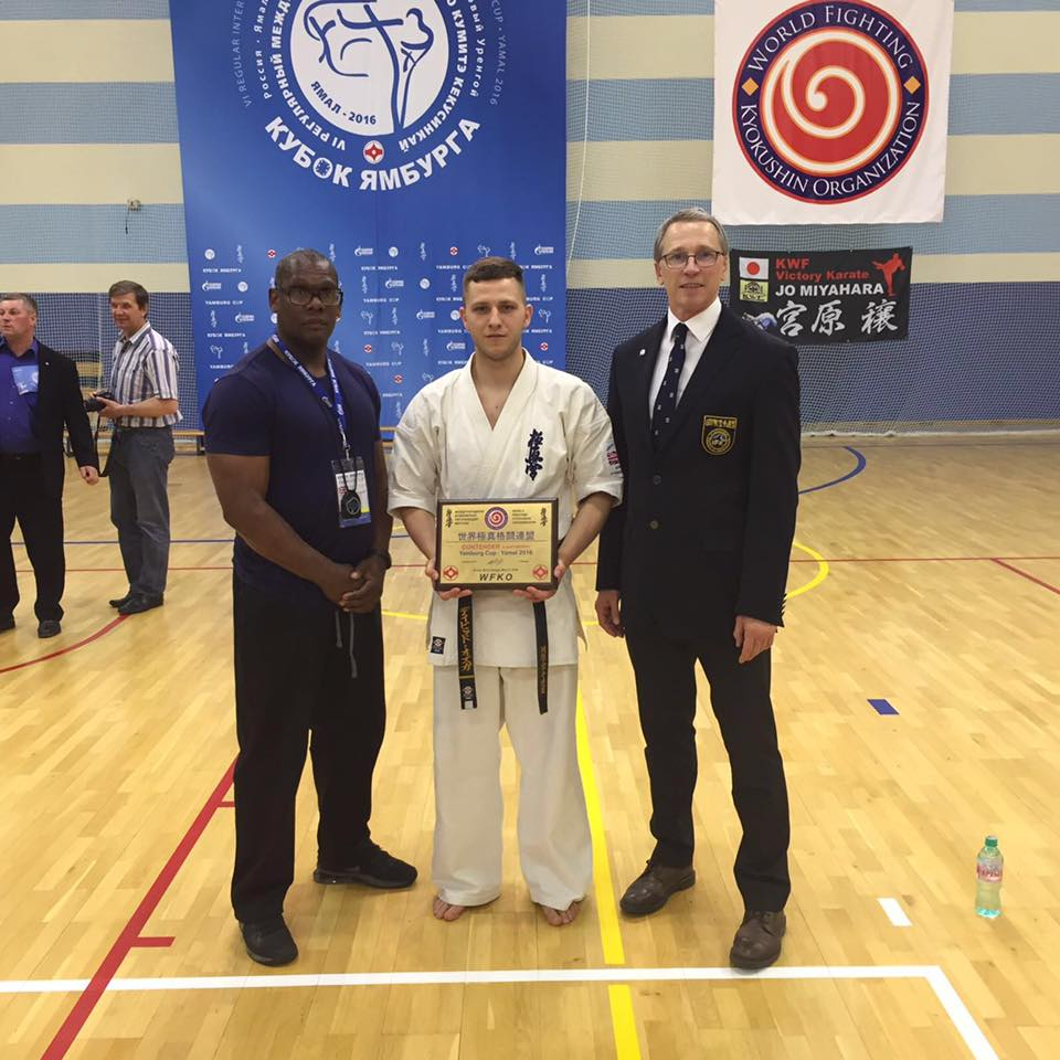 Senpai Kenny Jarvis and Shihan David Pickthall flank Dawid Ozga