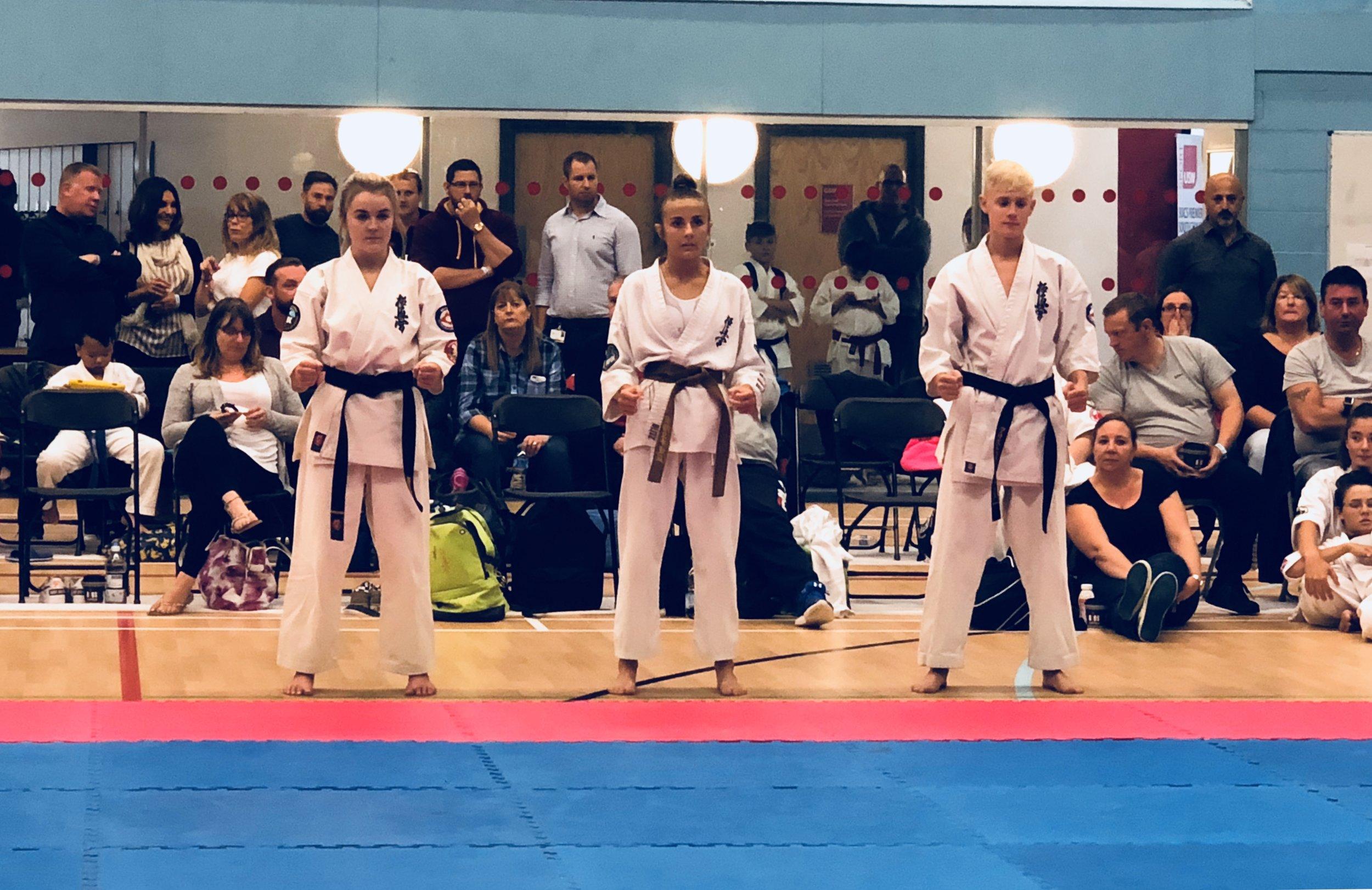 High Grade Kata finalists (L-R): Mia Morgan BKK Wales (2nd place), Chloe Slocombe BKK England (3rd place), Luke Davies BKK Wales (1st place)