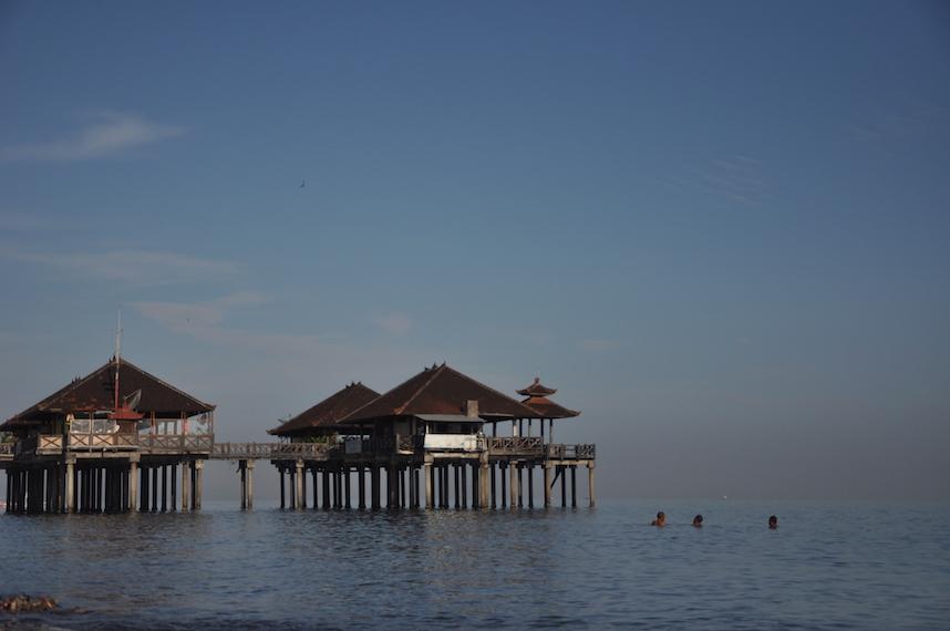 Swimmers near Pier in Bali Sea
