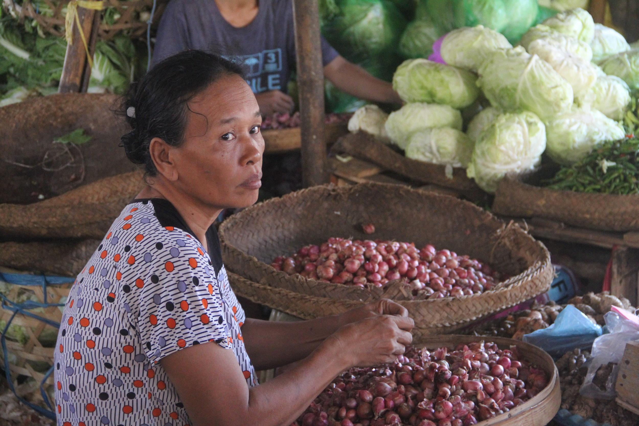 Woman Sorting Shallots