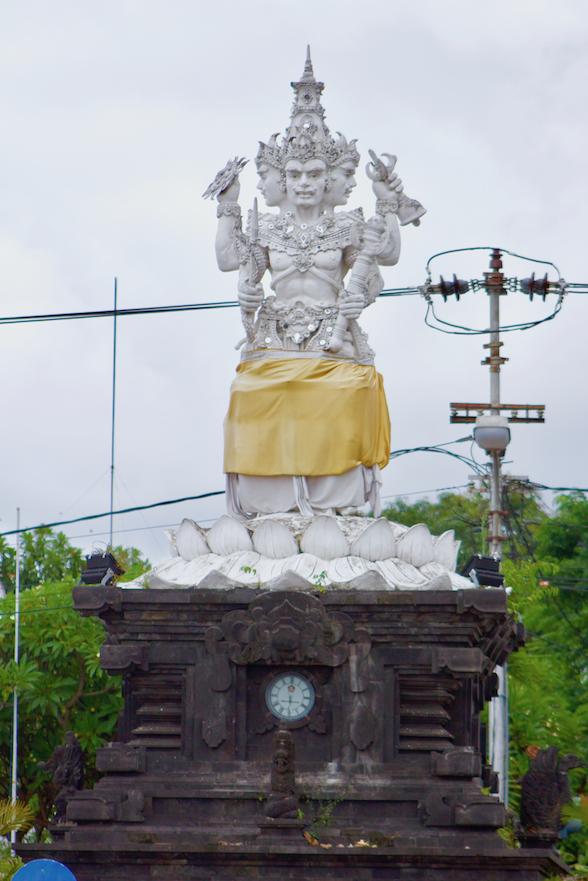 Four Faces Statue