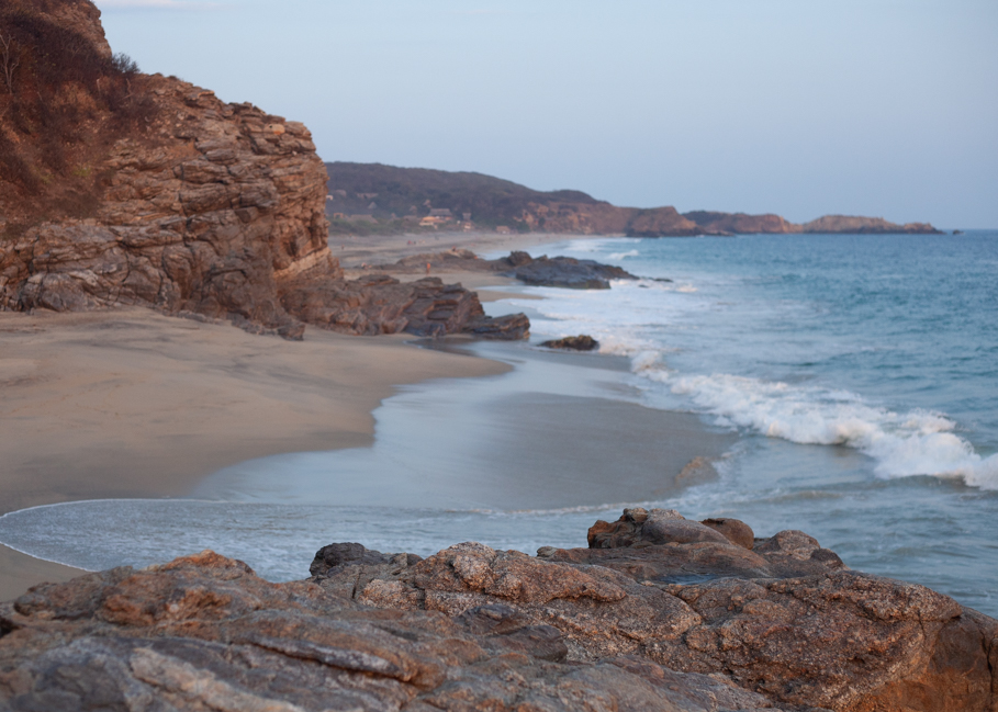 At the far end of the beach is Punta Cometa. You can see it at the top right corner, of this image. This rocky scape boasts hiking trails and a great sunset view. It's the most southern point in the Oaxaca province.