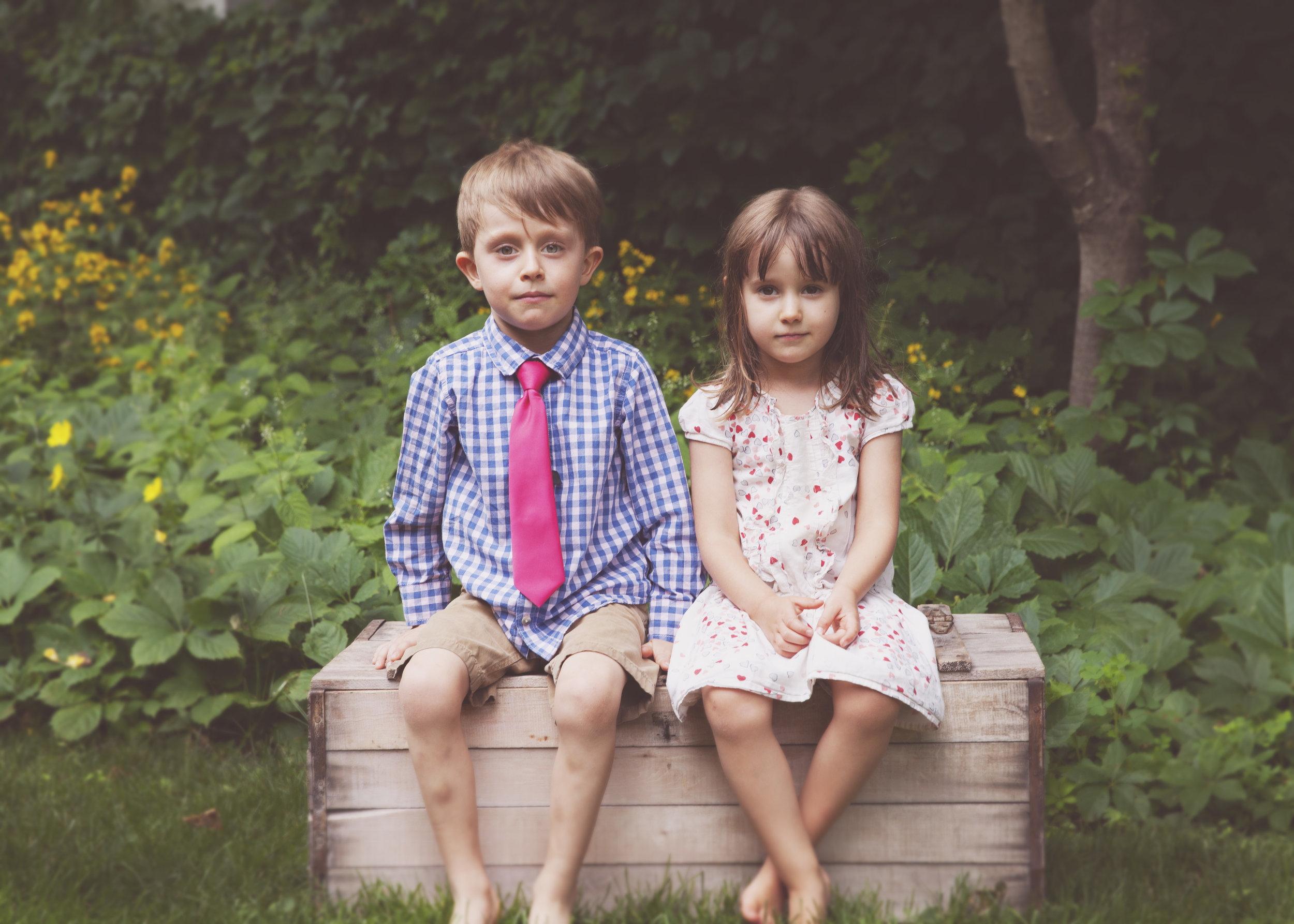 """This photo was taken at the 50th wedding anniversary. I brought this old trunk and it became the more """"posed"""" photo spot. The rest of the celebration were candid shots, that demonstrated emotion and joy."""