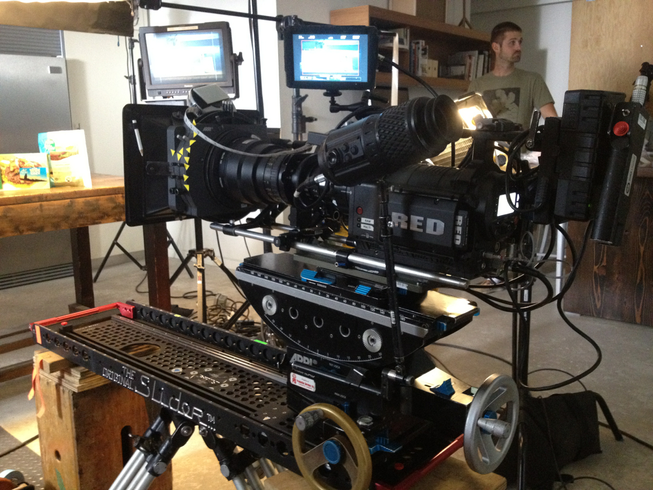From today's job- a RED1 system with a 25-250mm zoom.  Remote focus via Barrtech system as anything connected to the camera might have compromised the smoothness of the move- made use of an Arri geared head for precision framing and operating on the buttery Original Slider.Also had a Microforce zoom control attached. Power was provided AC while remote focus was v-dock batteries.