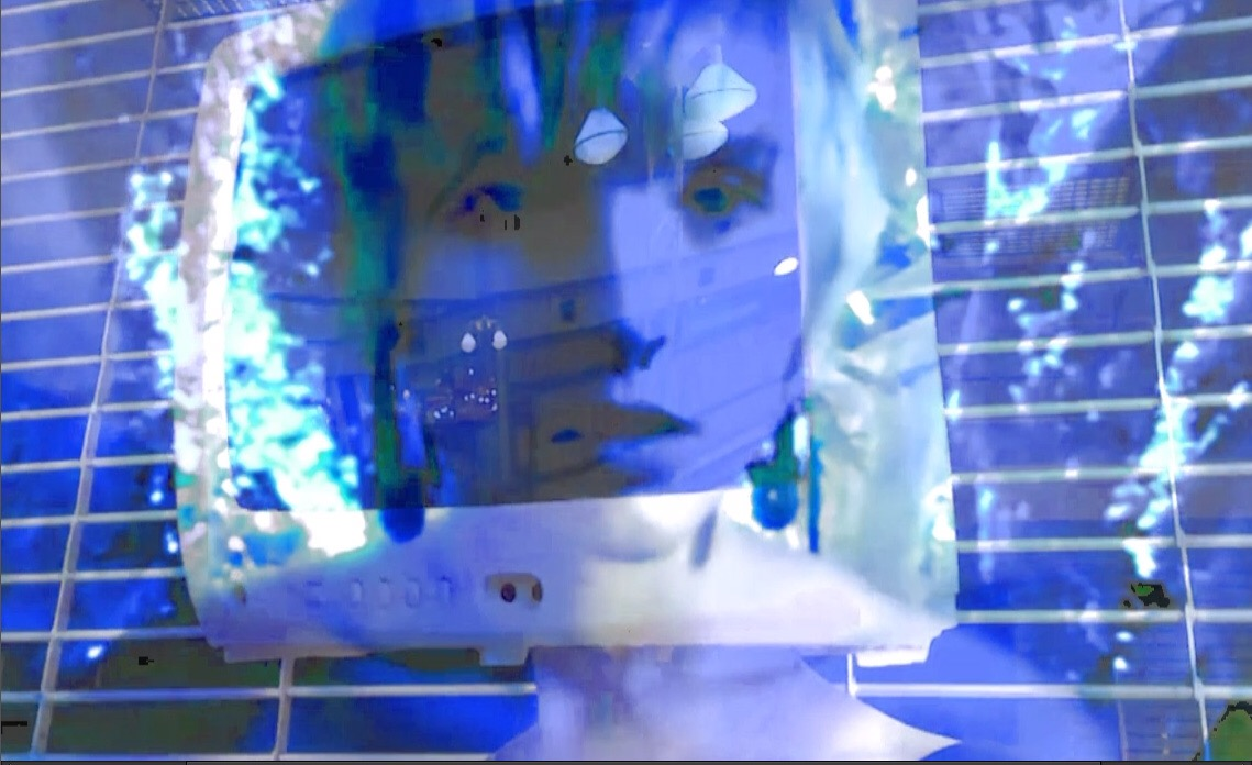 """Screen cap from a music video featured in the show.  View '""""Something Computer"""" music video here."""