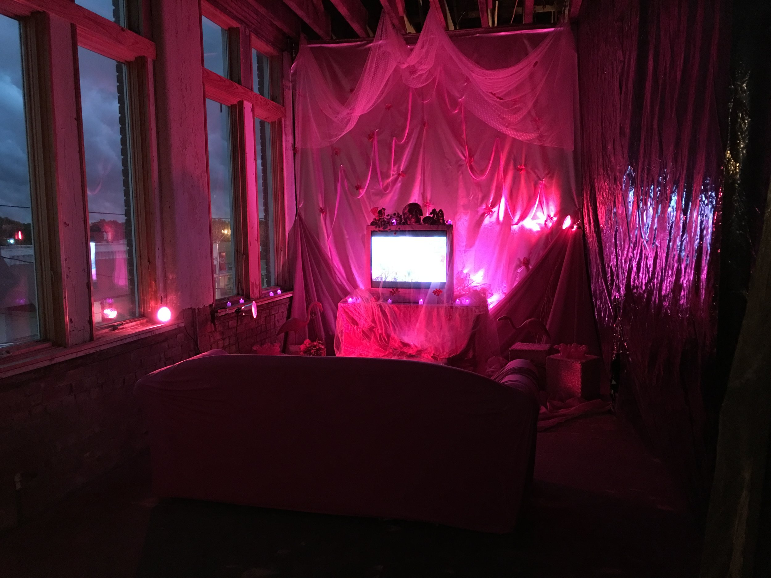 Installation at Momentum Ada at night.  View the full video here.  Pink Hell is an experimental series of video loops that began in 2015. The quality of these loops are meant to conjure up feelings of being in a VHS dream. The project exists as a virtual blog and was part of a small site specific installation that traveled around the metro. This project was selected for Spotlight in the New Media category for Momentum Ada (May 2017)