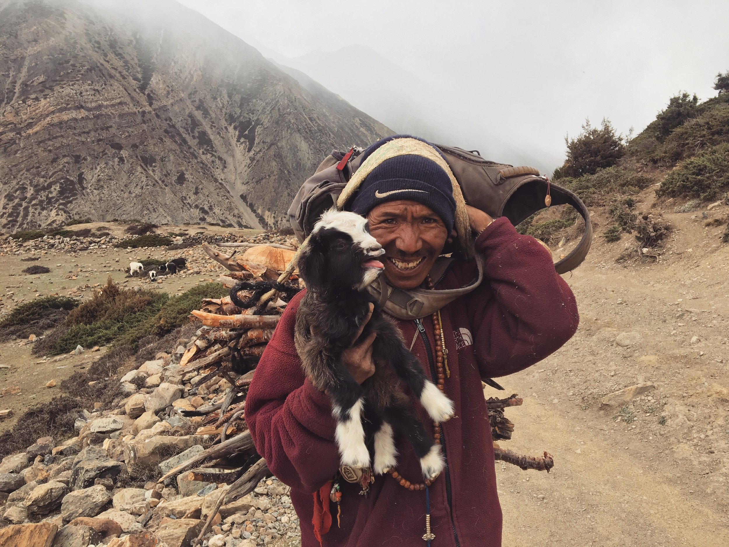 Happiest man and a screaming baby goat.
