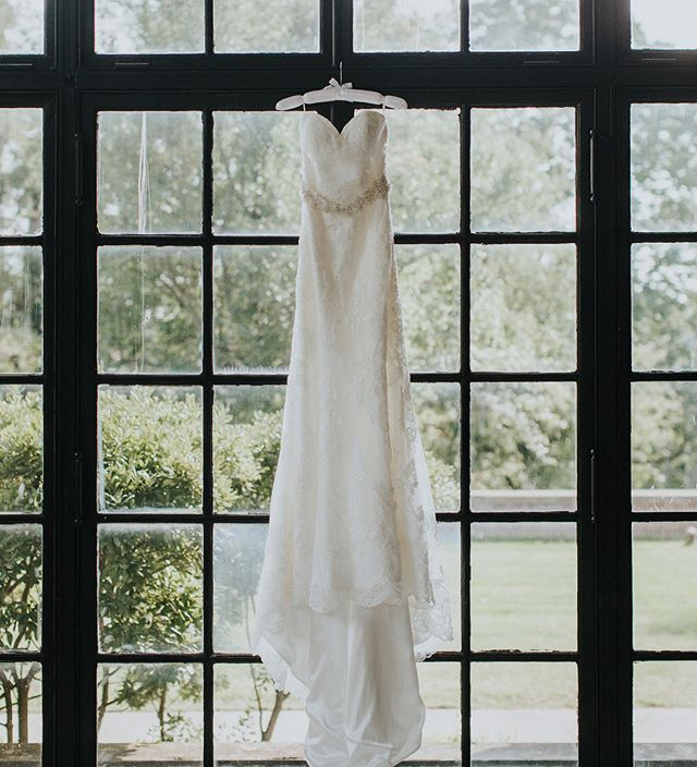 I've never felt like dress shots were my thing but lately I'm loving them! This sunroom at Gardencourt made it especially easy.  Swipe to see the dress on a super stunning Bride!! #bride #weddingdress #louisvillephotographer #louisvillebride #louisvilleweddingphotographer #weddings