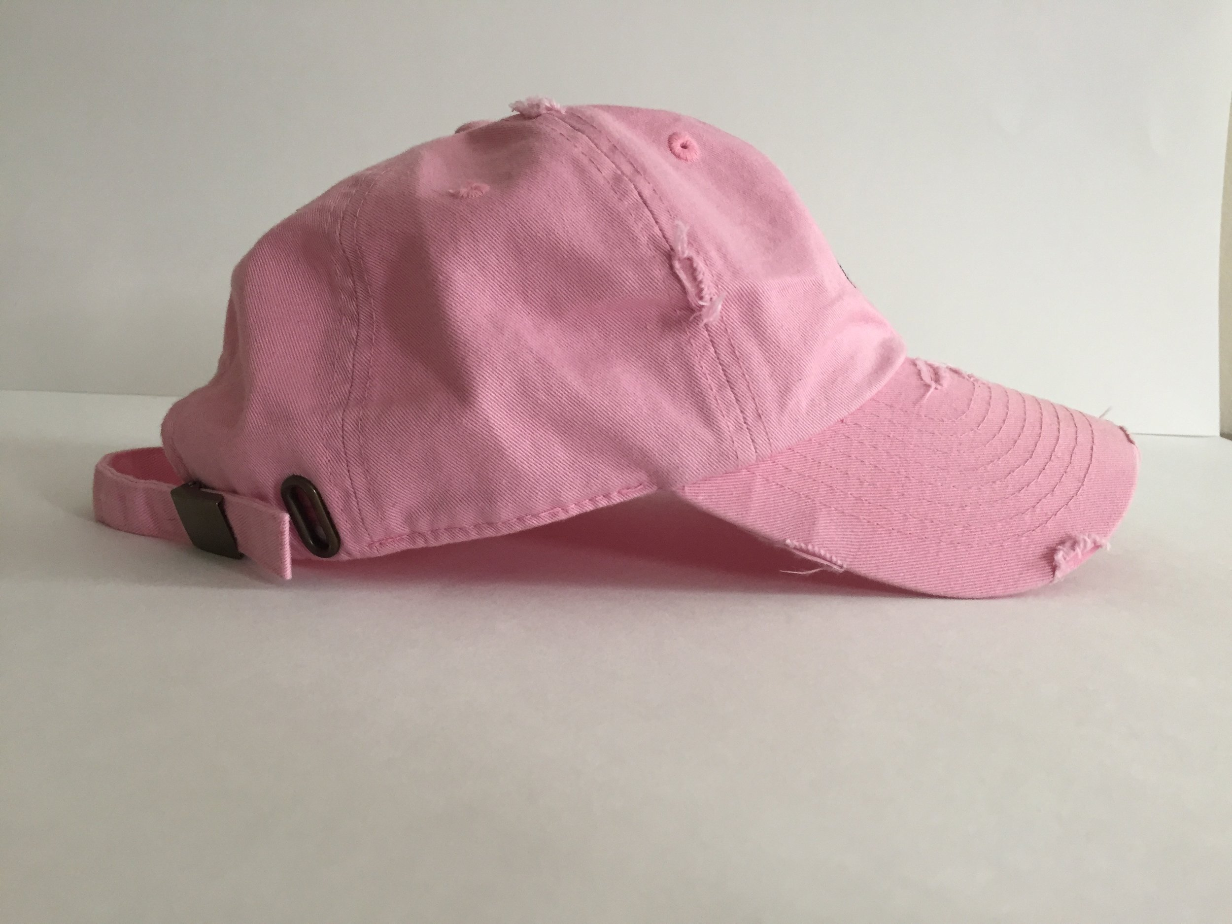 "Distressed pink ""Clout"" dad hat (side)"