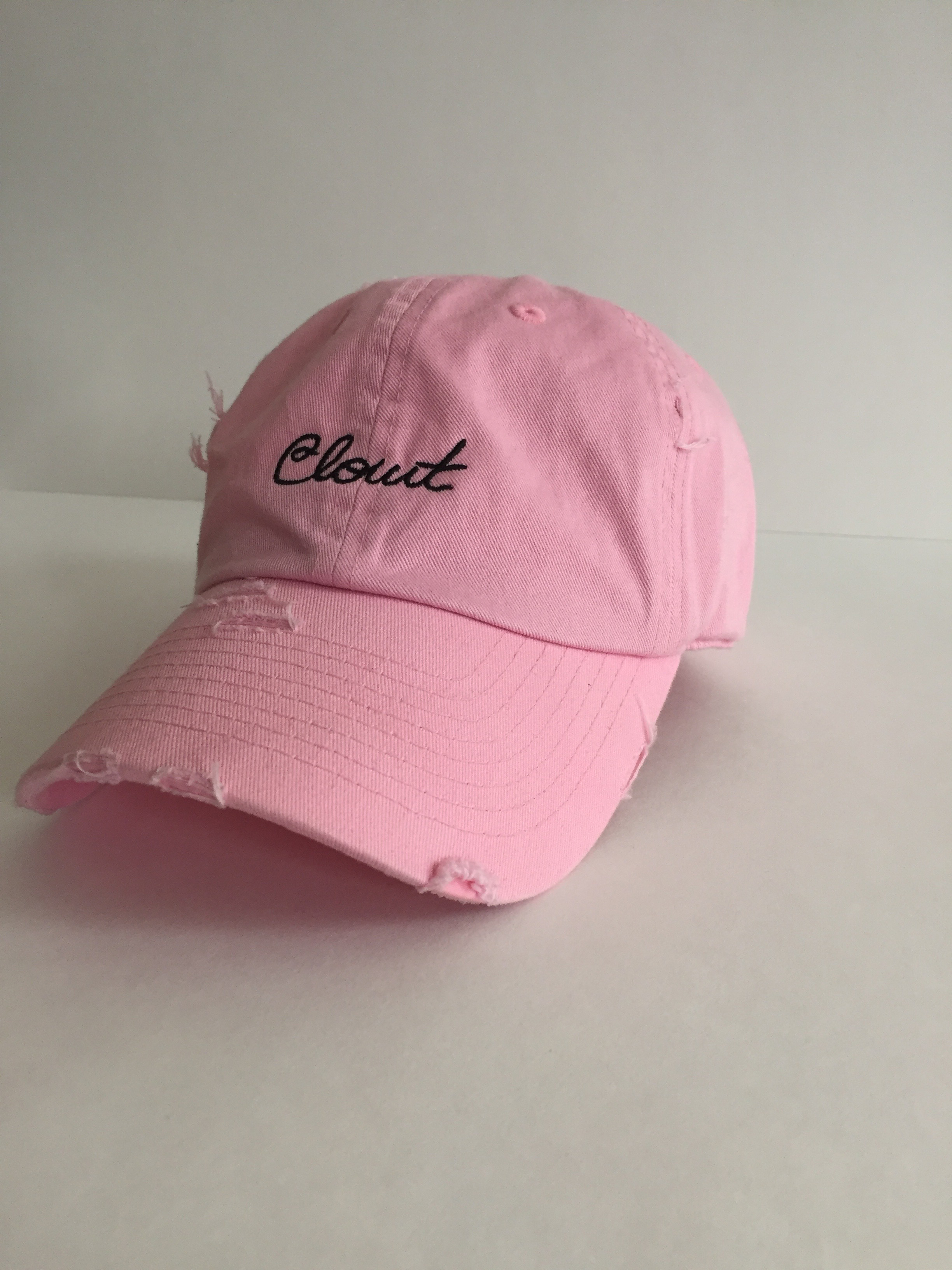 "Distressed pink ""Clout"" dad hat (front)"