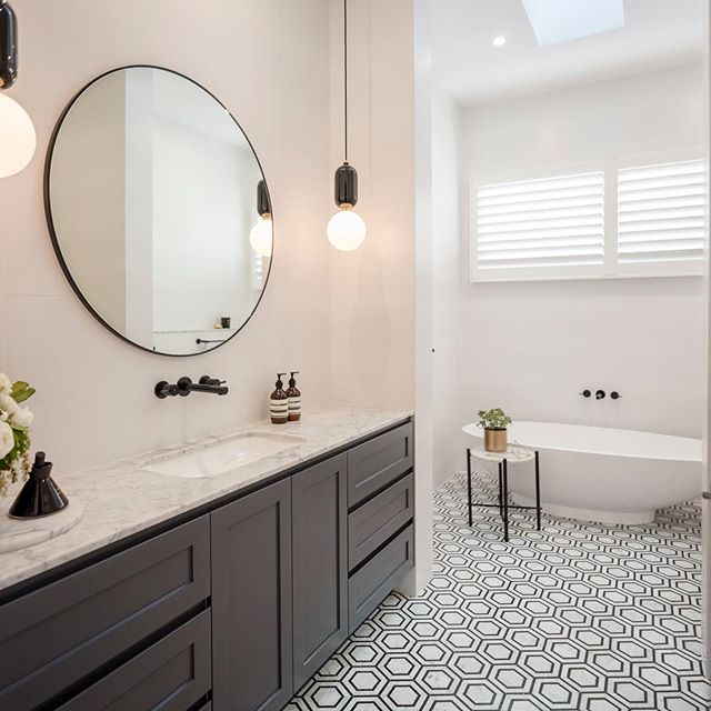 Another shot of our Drummoyne Home project, now on our website.  #interiordesign #interior #design #styling #decor #instastyle #blackandwhite #bathroom #bathroomdesign #freestandingbath #custom #monochrome #classic #tiles #geometric #carrara #marble #luxe #renovation #remodel #inspiration #sydney