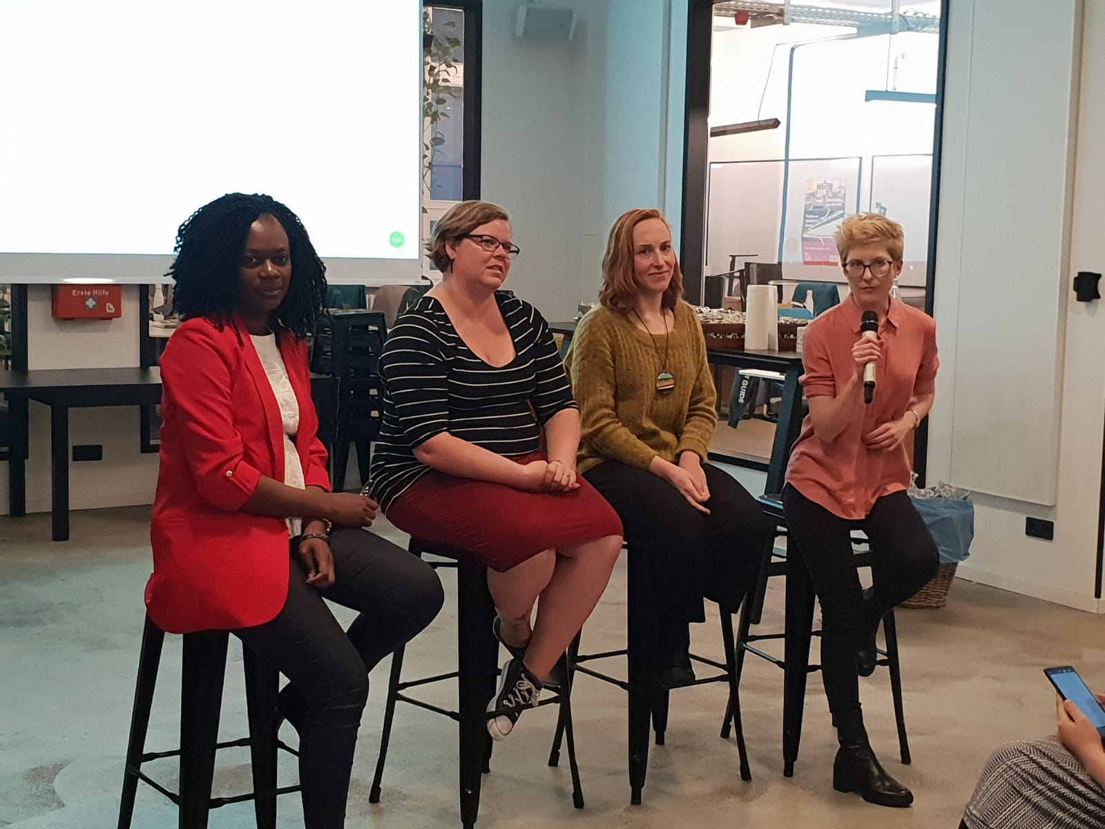 Anna participating in a panel at a Women in Data Meetup