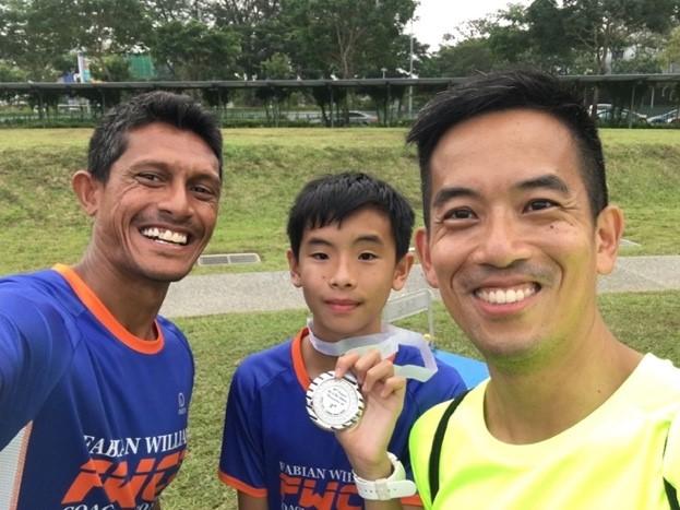 Coach Fabian, Shaun, and his dad.