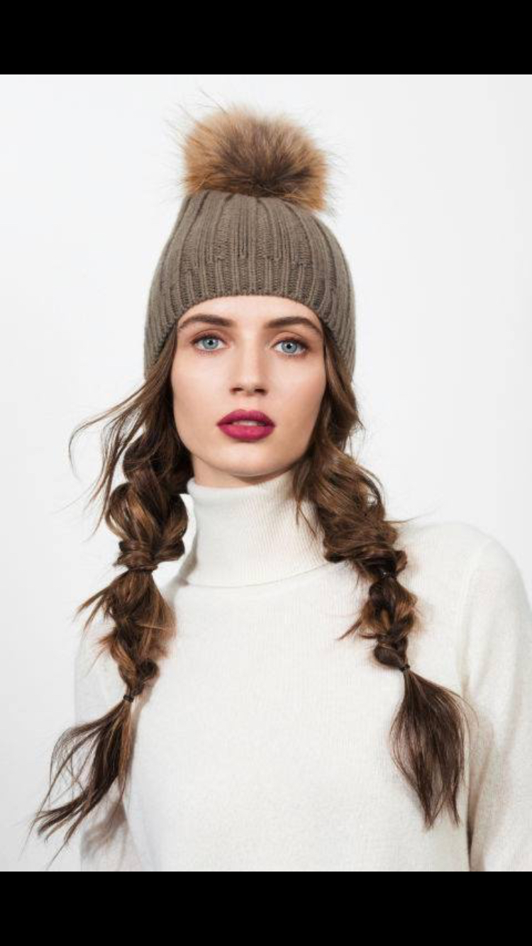 Pigtails! - If your plaiting skills aren't up to the KK look, this cute look is quick, easy and simple.Simply divide your hair into two sections and create a simple braid each side. This look can be personalised by fanning the braids out to give a more modern boho look and can feel very comfortable under your helmet and a secure fit.