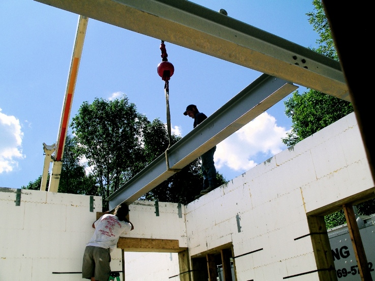 Iron beams incorporated into pockets in ICF
