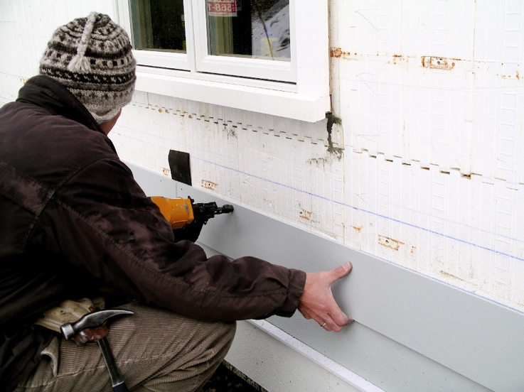 Fiber-cement siding attached to ICF web with pneumatic nailer