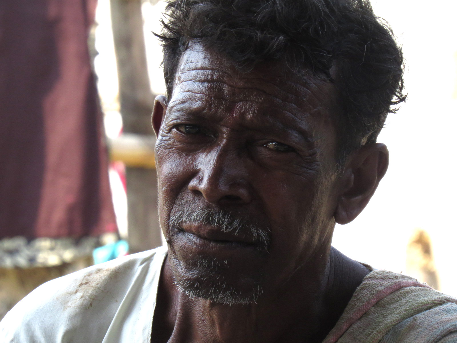Concerned farmer discusses late monsoon rains