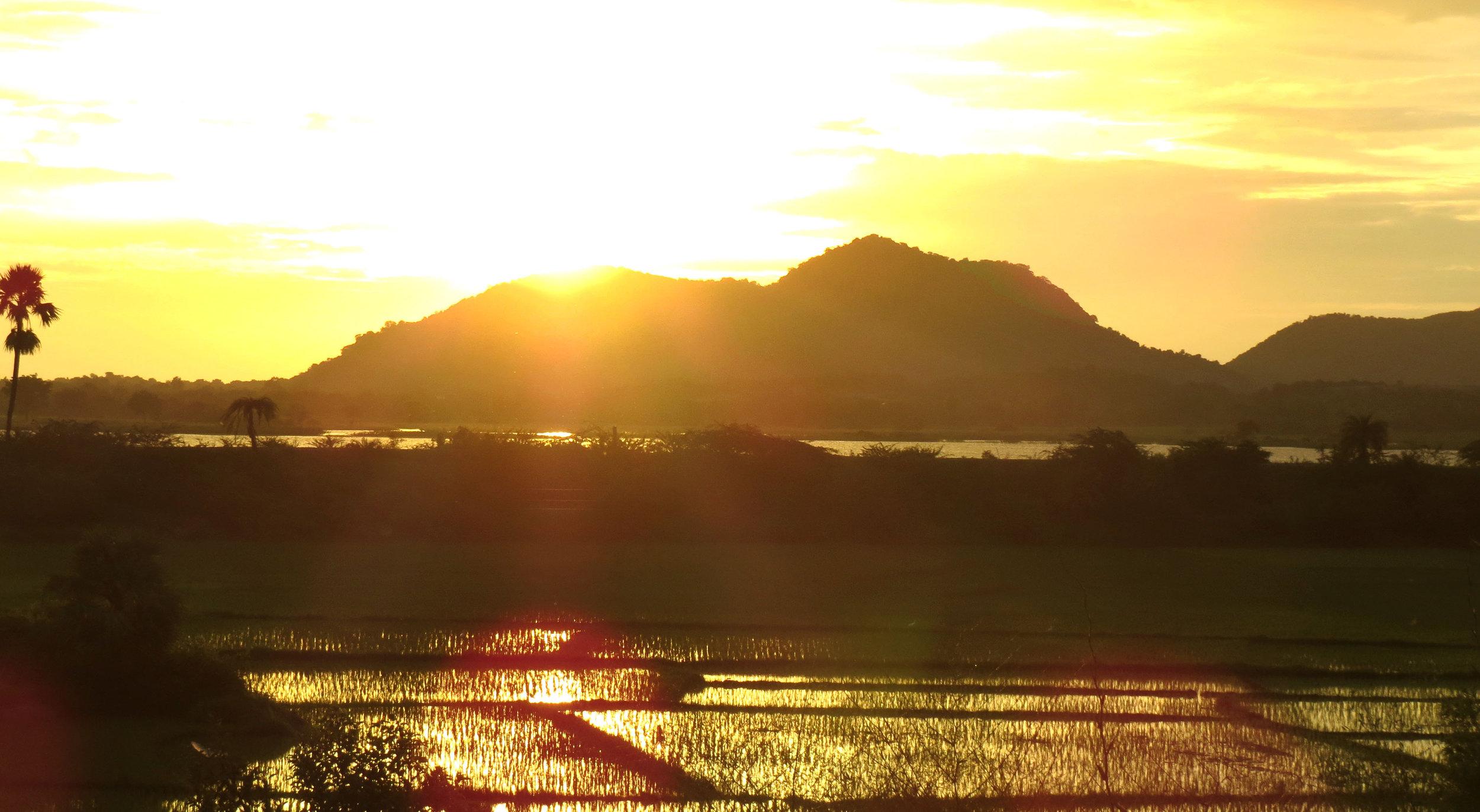 Sunrise over human-made lake irrigated fields