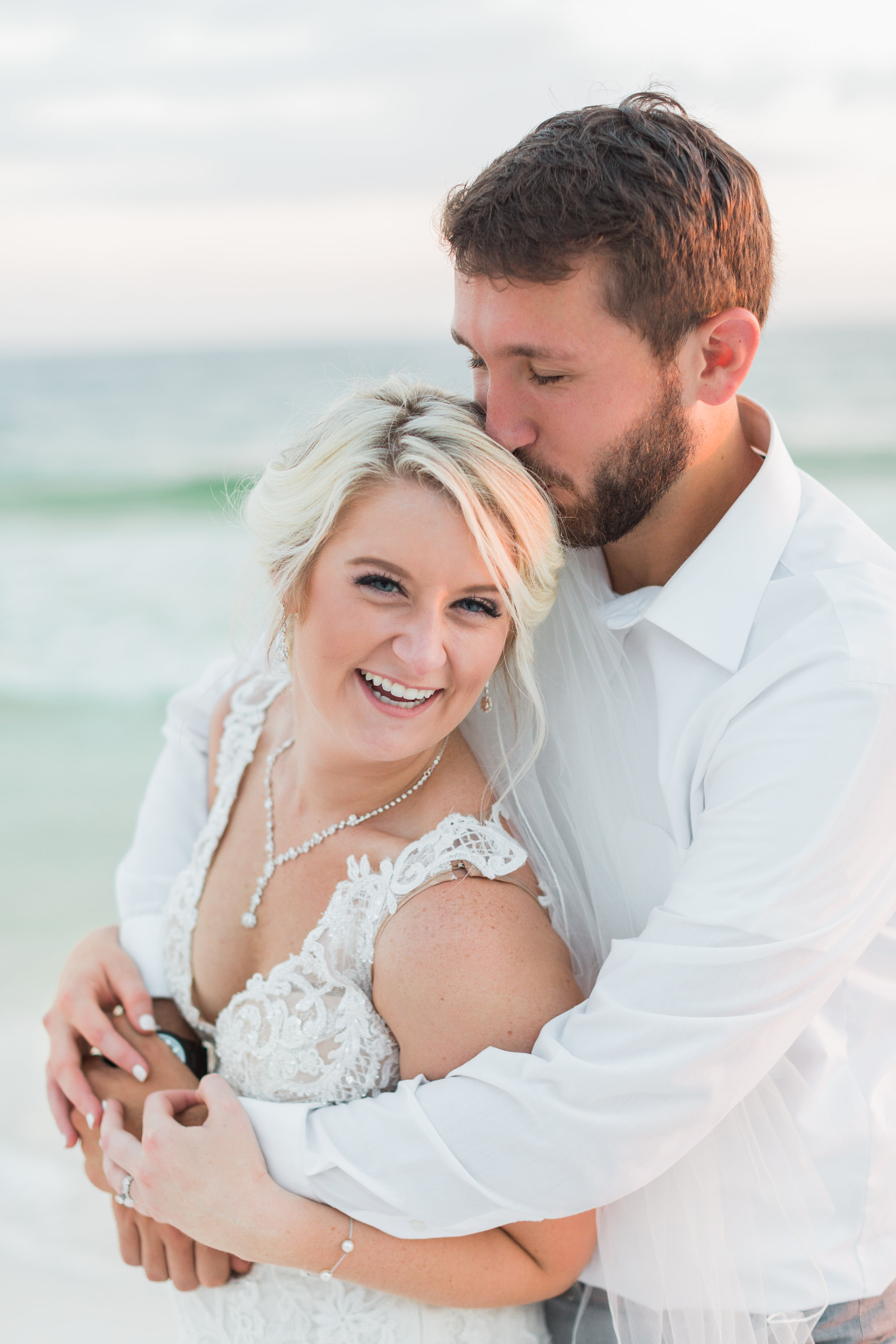 """Hannah was a part of our big day from the very beginning! She was there for when Tyler proposed to me at the airport (my husband is a pilot, so of course he chose to do it there), our beautiful engagement photoshoot at (and in) a waterfall, and our wedding on the beach in Florida. To say she can shoot anywhere and in any kind of weather is an understatement! My husband and I originally planned to get married in April and immediately knew we had to have Hannah for our BIG day. When we had a couple of issues with our wedding venue here in Georgia, we decided to change everything up and get married in October on the beach instead! Knowing that we had already planned on having Hannah for our wedding day, we had no clue if she would have our new wedding date available or if she'd be able to come down to Florida. With so much luck, she and a friend were available that weekend and drove all the way to Miramar, Florida for us! Because Tyler and I planned our wedding from Georgia, we had no clue what to expect for the day of. There were a ton of details that you always dream of being photographed for your big day, and I had no clue as to what to tell Hannah what everything would be like. She was so easy going with the whole day and even got all of the detail pictures I wouldn't have even thought of. Even when I started stressing out about running late (or losing my jewelry), Hannah was so sweet and calming and assured me that everything was going to be alright and we would make it to the wedding. Thank you so much for capturing our most perfect day and all of the big events that led up to it. All of our pictures are so gorgeous and remind me everyday how much love the two of us have for one another. Thank you!""  - Tara"