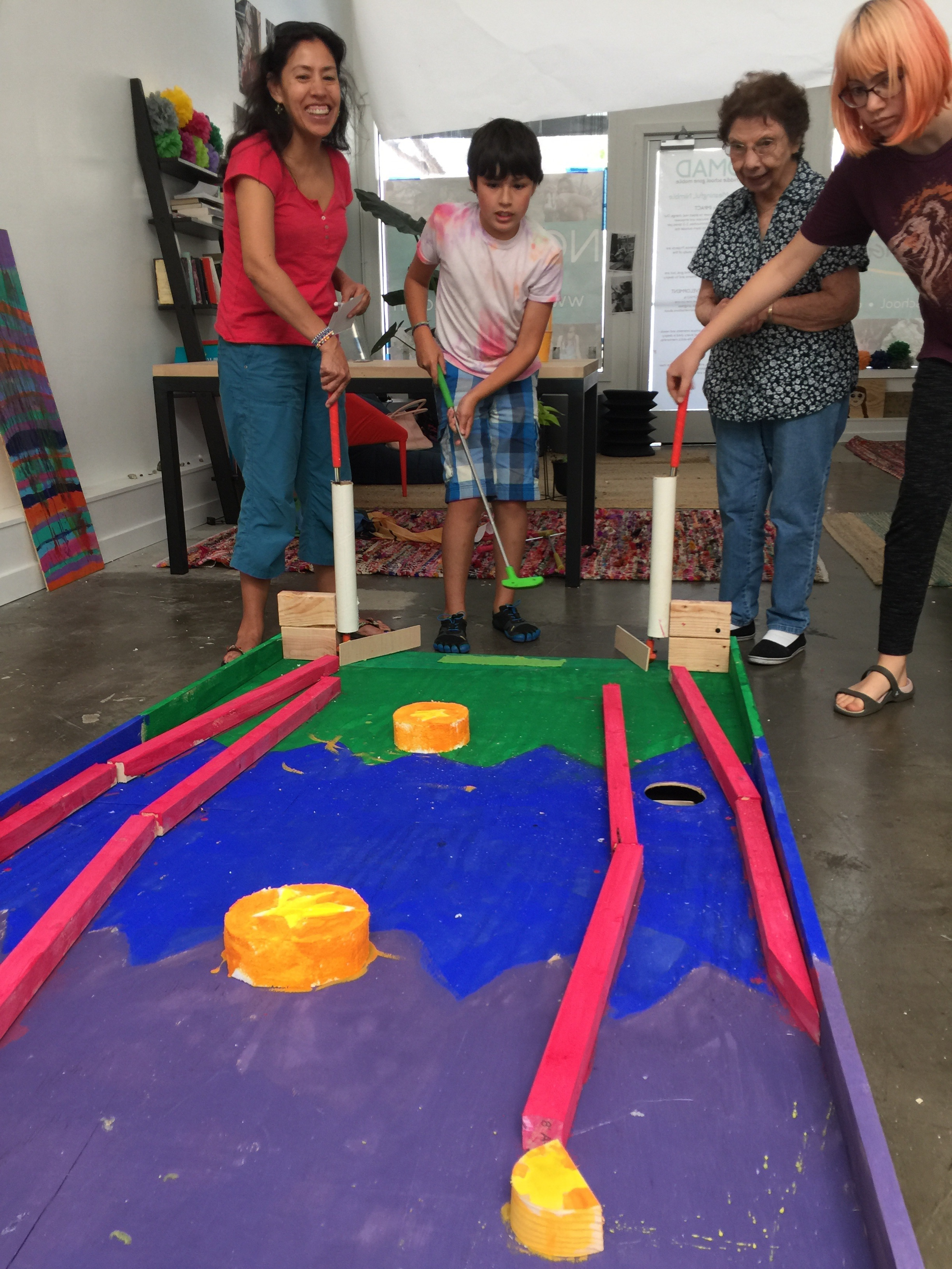 Alex's pin-pall hole was a hit because it was a challenge to navigate the many bumpers and tracks with the putters-turned-flippers at the base. You'll notice the stragically placed hole which required the player to calculate angles and speed.