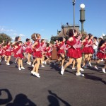 Elite dancers in the afternoon parade at Disney dancing to Jingle Bells.