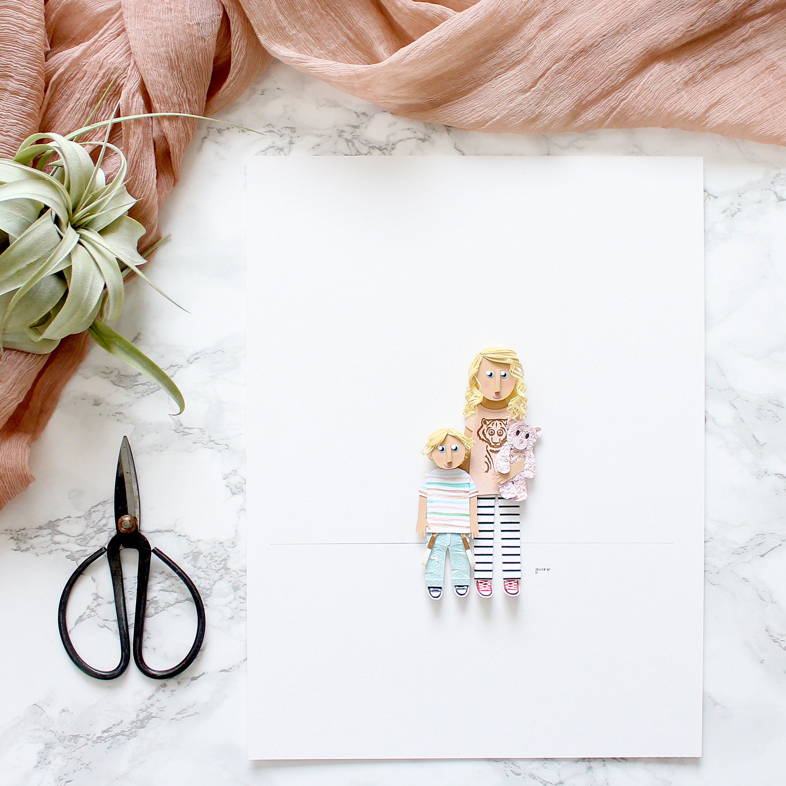 A unique spin on your traditional family photo by paper artist Brittani Rose Paper.