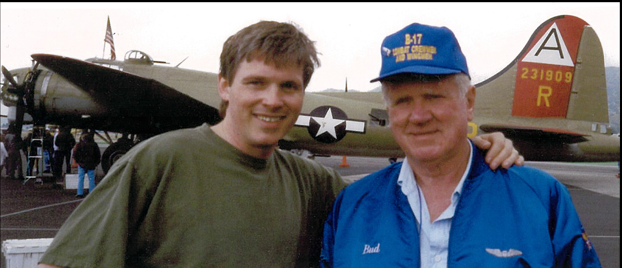 """Bud and Mark- May, 1998, Burbank, California   Mark Kirkland (left) and Bud Kingsbury (right) after meeting each other, by chance,   aboard the B-17 """"Nine O' Nine,"""" seen in the background."""