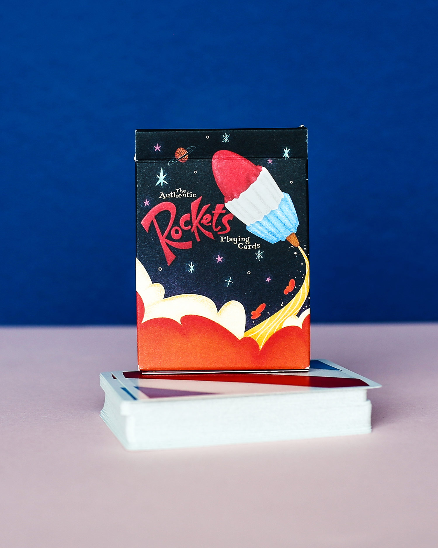 Rockets - As the go-to designer for Ellusionist, Oban works with a team of highly skilled magicians and product creators. This team is constantly reinventing an ancient tradition and he is proud to be a member of this creative cohort.The Rockets playing cards feature classical cartoon styling, inspired by 1960's illustration in homage to the classics like Hanna Barbara.They have a fun and summery feel, with a bright and bold palette.Working outside of his usual wheel house, Oban researched and adapted his illustration style to fit the lighter, more playful tone of the project.