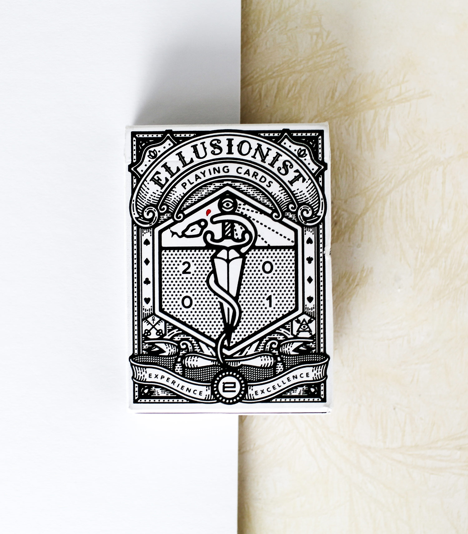 The Ellusionist Deck - The Ellusionist deck was designed as a celebration of the companies heritage, filled with easter eggs that refer back to past products and projects. Oban illustrated the packaging to have the feel of a classical sideshow attraction, whilst the clean, minimal style gives it a modern edge.Produced originally as a staff only deck for Ellusionist employees and for use in filming project and promos. It was later released to the public for a brief period and became one of Ellusionist's fastest selling decks.