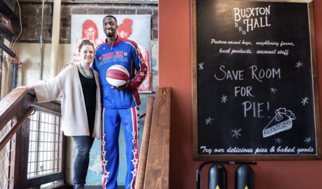 "Harlem Globe Trotter, Chandler ""Bulldog"" Mack, loving life and lunch - Buxton Hall BBQNot just in a food-as-fuel way, though his work requires him to be fleet of foot and execute high-flying dunks. But the fact that the 26-year-old loves to eat was as plain as the broad smile on his face when the server at Buxton Hall delivered his pulled-pork lunch.Watch the video here."