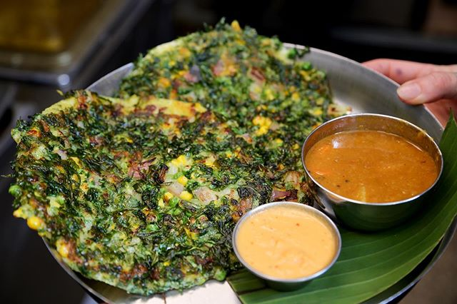 Mixed Veg or Tomato & Cheese?? Which Chai Pani Uttapam is your fave? 👌🏽⁣ ⁣ Uttapam is a South Indian specialty - a savory, pancake-like dish made from rice & lentil batter, with a variety of toppings. We serve ours with sambar (a South Indian lentil-based vegetable stew), and coconut chutney. ⁣ ⁣ MIXED VEGETABLE UTTAPAM (Vegan):⁣ Corn, peas, onion, cilantro, curry leaf, ginger, & chillies.⁣ ⁣ TOMATO & CHEESE UTTAPAM (vegetarian):⁣ Tomato, cheese, onion, cilantro, curry leaf, ginger, & chillies.