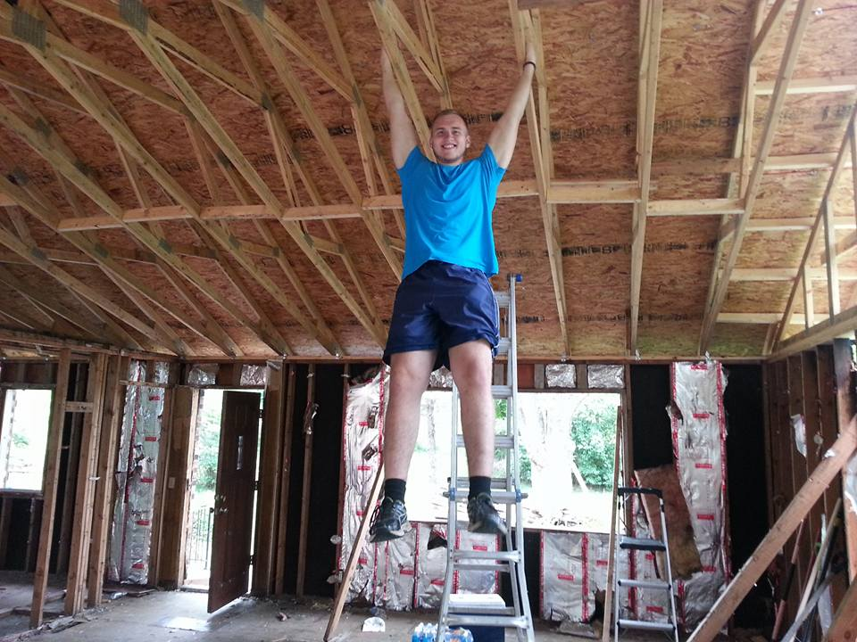 My son Jonah, helping rebuild our house... sorta