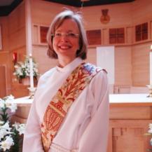 The Reverend Paige McKay ,  Deacon