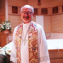 The Reverend J. David Perdue,   Rector