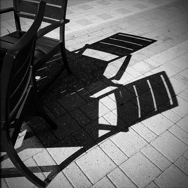 #bw #photography #patterns #lines #shadow #architecture #patio #photographer #iphonesia #furniture #table #chairs #architecturephotography #iphoneonly #instagood #instadaily #geometry #art #streetphotography #line #raleigh #raleighconventioncenter #nc @raleighconvention