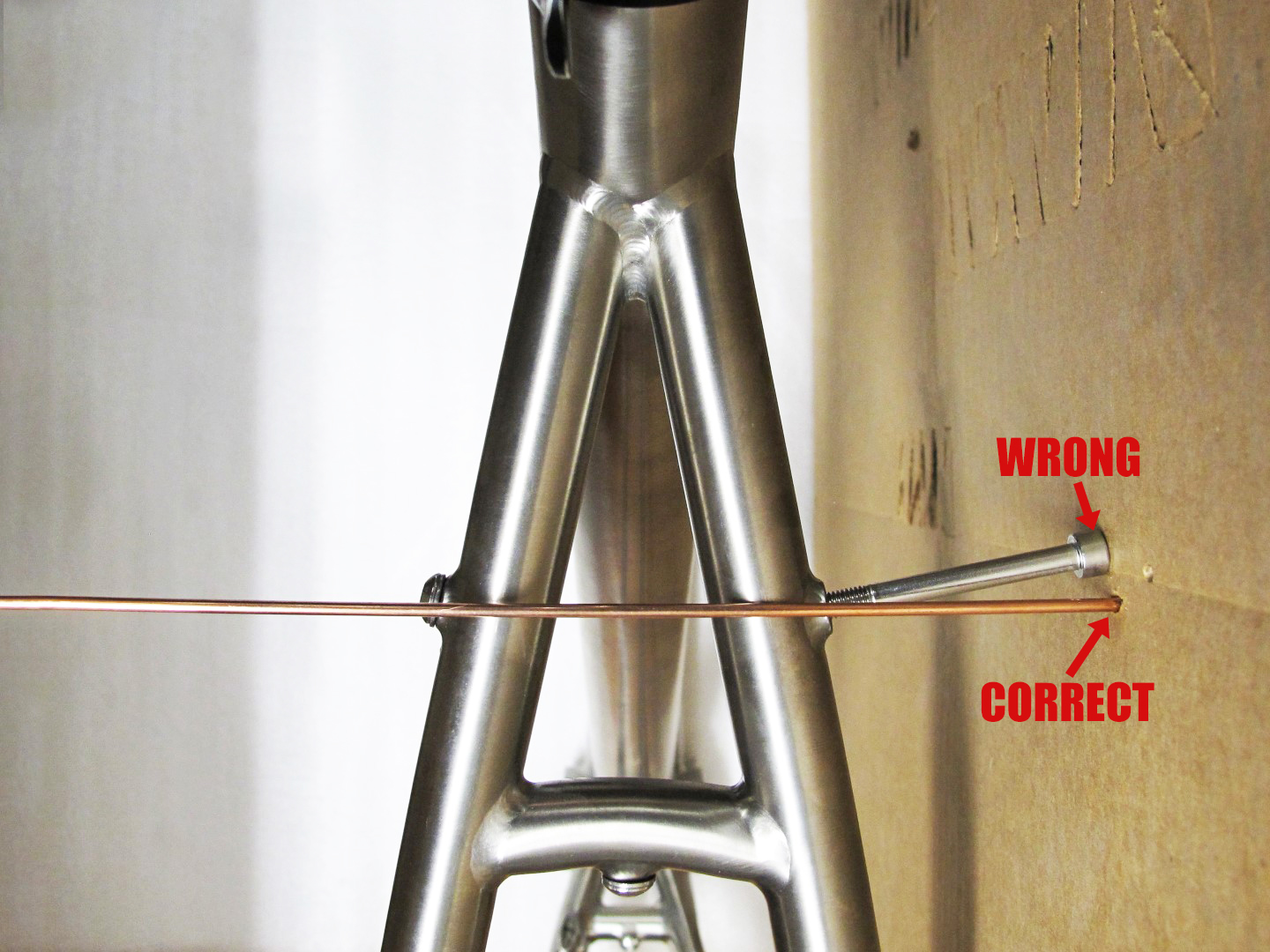 NOTE: Because upper rack mounts are generally not square with the frame center line, using a long bolt threaded into the eyelet will give an incorrect position.