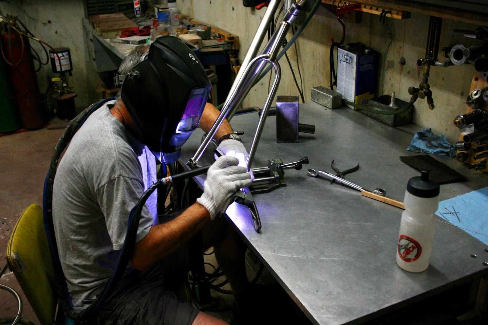 TCF-Shop-Framebuilding-Dave-Welding-Frame-Side.JPG