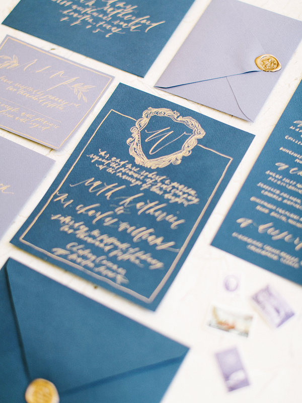 gold-blue-calligraphy-wedding-invitations.png
