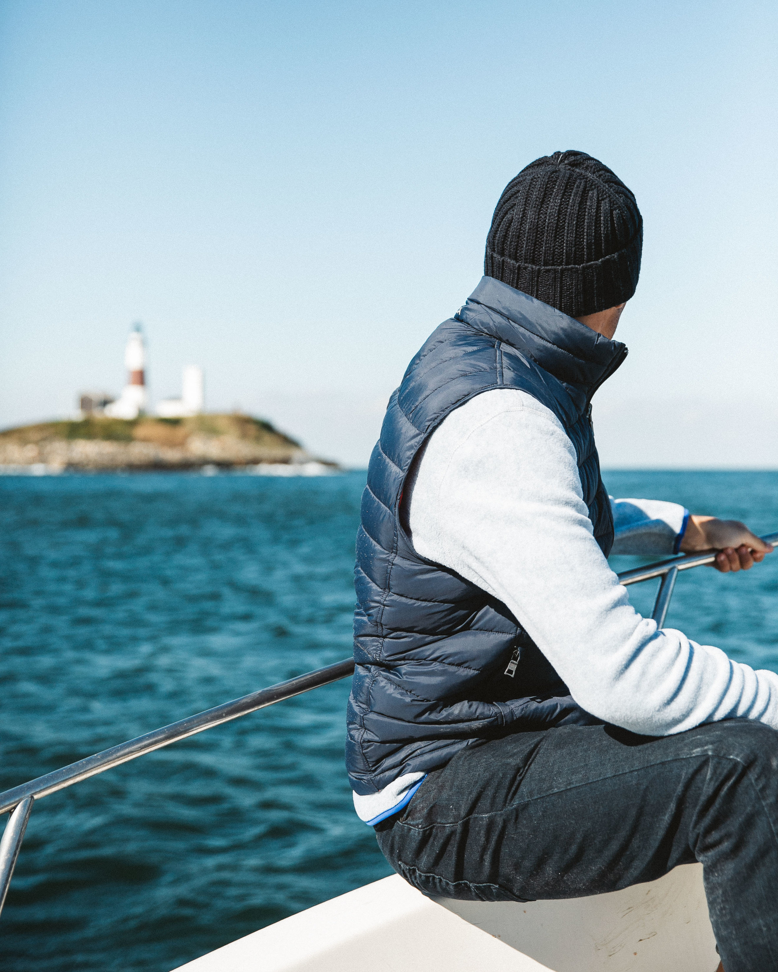 An hour of diving in the water off Montauk in October will chill you to your core… here I am trying to warm back up on the boat ride in.