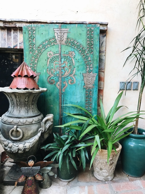 travel photograph san jose del cabo mexico hand carved wooden turquoise door pottery plants