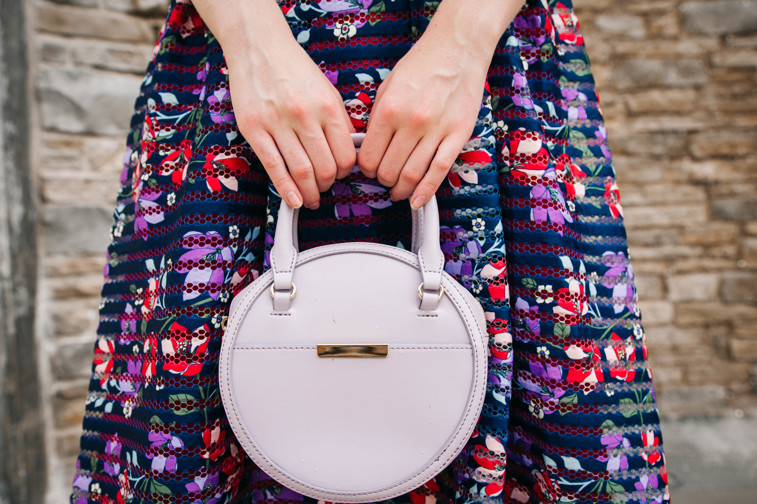 Best dress to wear to a wedding this season and matching lilac handbag