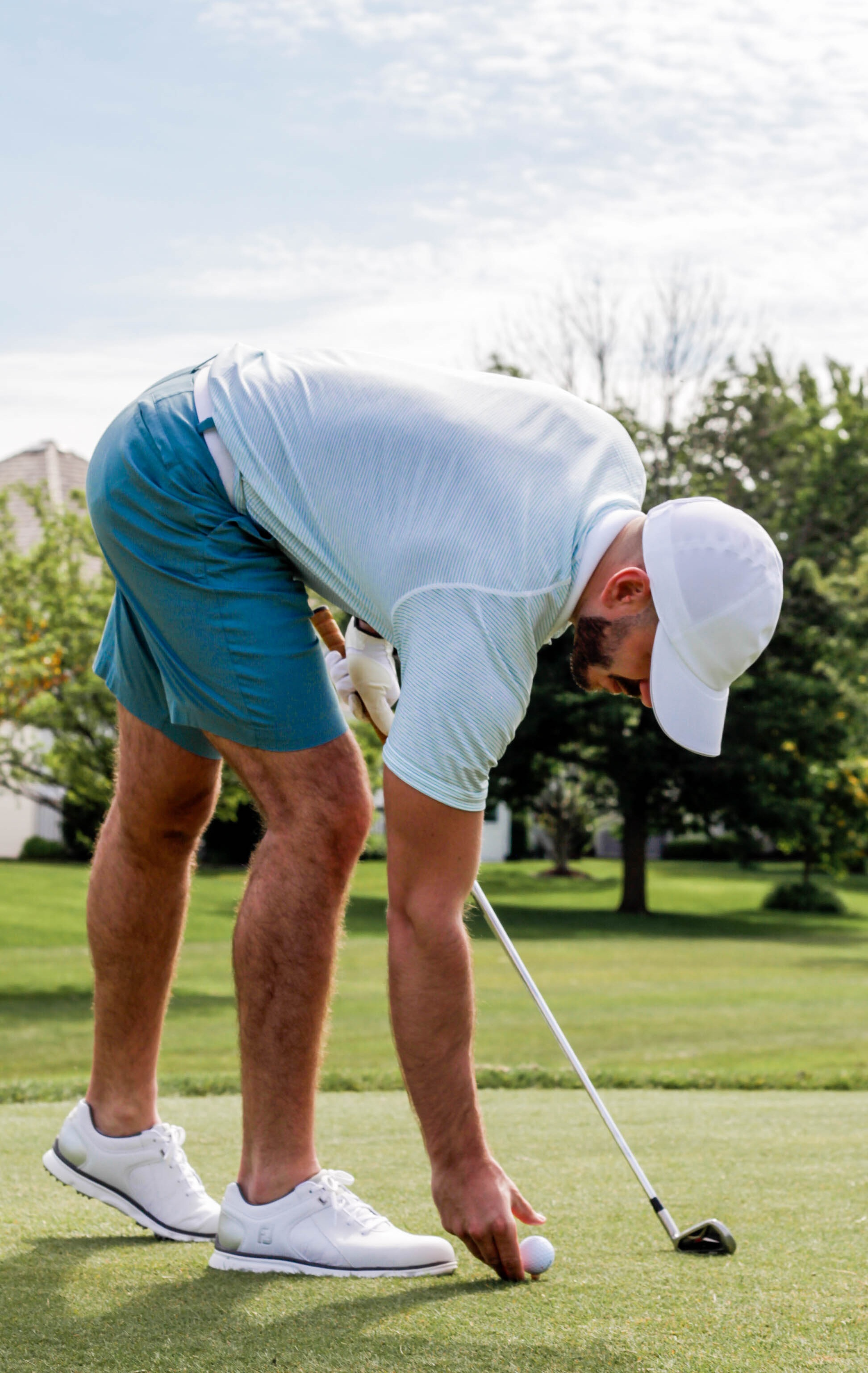 """Wearing: lululemon Commission Short Chino 9"""" Slim in Aquatic Green, Metal Vent Tech Polo in White/Blue/Lime, and Tillinger Poly Hat in White."""