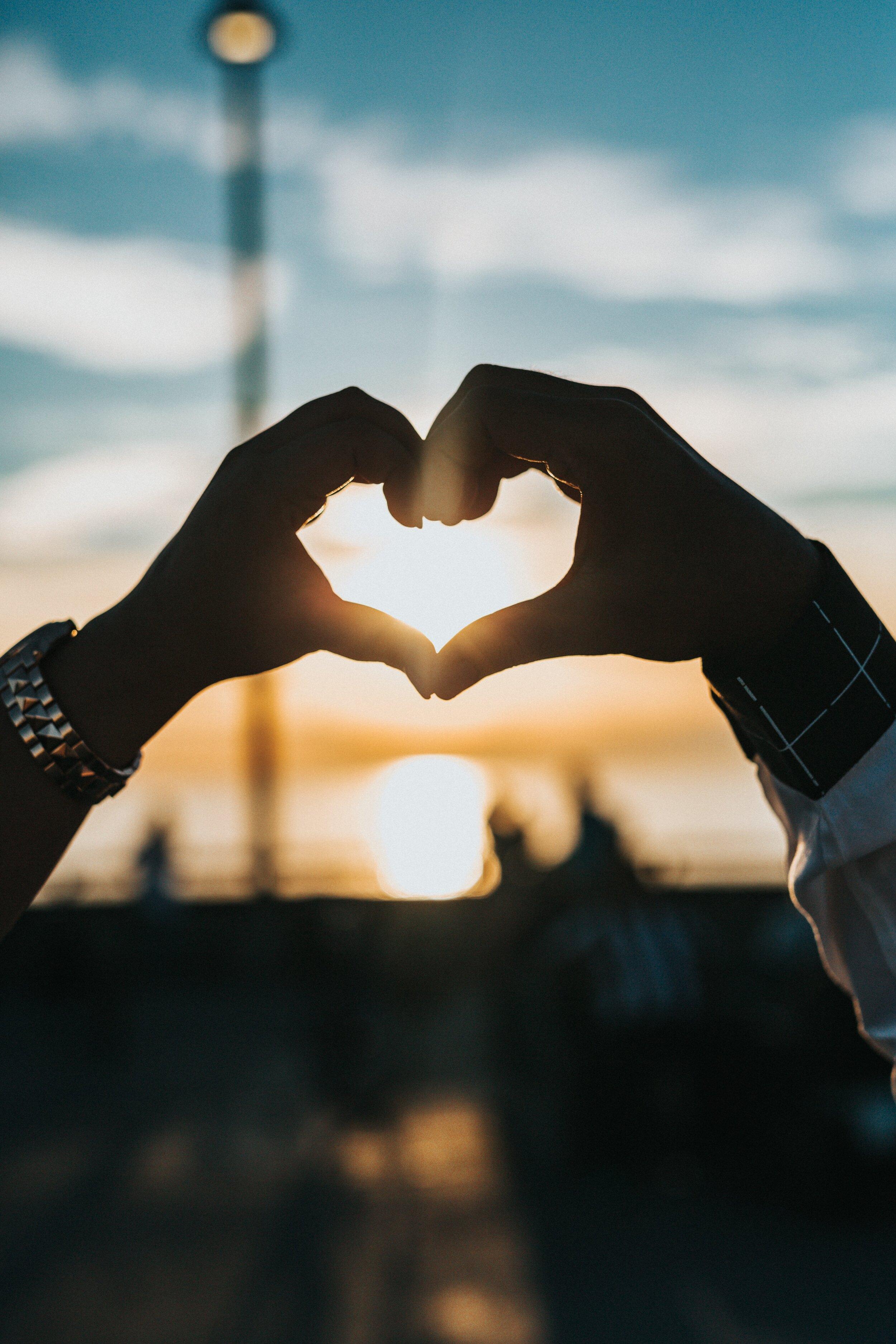 Love Hand Heart Photo by Tyler Nix on Unsplash